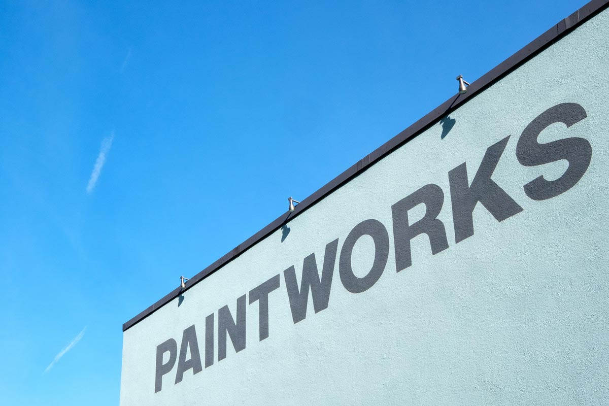 Paintworks painted on side of building at entrance to